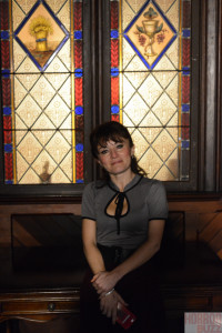 Elif in front of stained glass